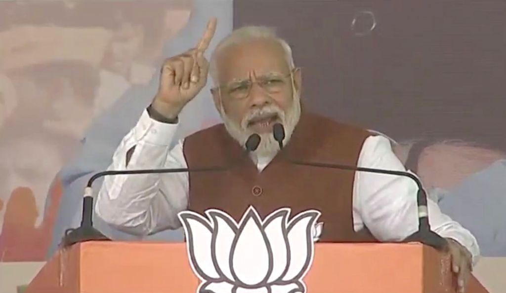 Prime Minister Narendra Modi addresses a public meeting in Dhanbad, Jharkhand on Dec 12, 2019. - Narendra Modi