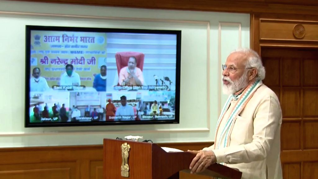 Prime Minister Narendra Modi addresses after launching 'Aatmanirbhar Bharat Rojgar Yojana' that will provide employment to 1.25 crore workers in Uttar Pradesh through video conferencing, ... - Narendra Modi