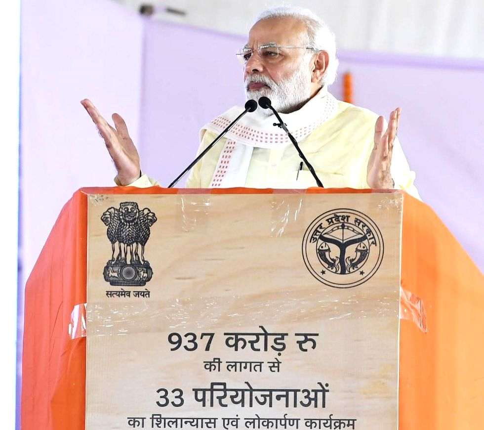 Prime Minister Narendra Modi addresses after inaugurating and laying the foundation stone for various development projects, in Rajatalab of Uttar Pradesh's Varanasi on July 14, 2018. - Narendra Modi