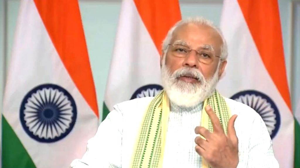 Prime Minister Narendra Modi addresses at the inauguration of a 750-MW solar project - said to be Asia's biggestat Rewa in Madhya Pradesh through video conferencing from New Delhi on ... - Narendra Modi
