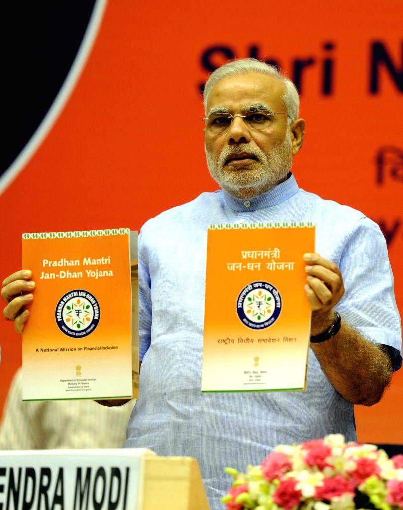Prime Minister Narendra Modi addresses at the launch of 'Pradhan Mantri Jan Dhan Yojana (PMJDY)' in New Delhi on Aug 28, 2014. - Narendra Modi