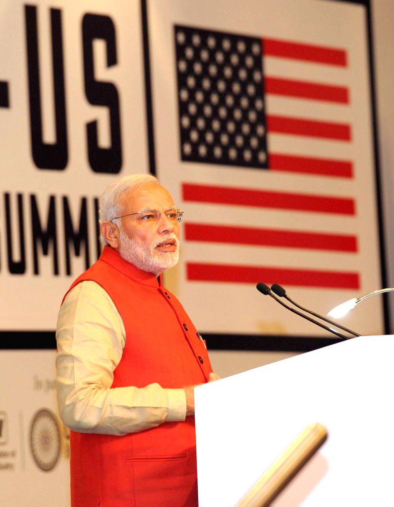 Prime Minister Narendra Modi addresses at the India-US Business Summit, in New Delhi on Jan 26, 2015. - Narendra Modi
