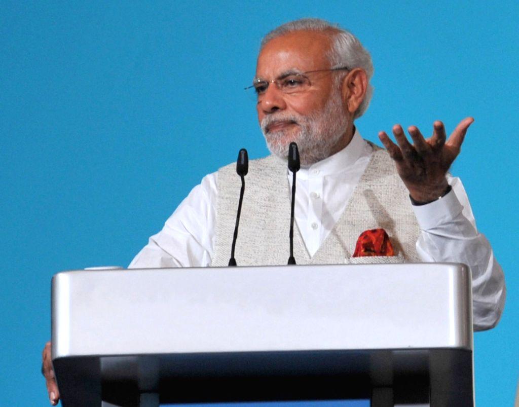Prime Minister Narendra Modi addresses at the 37th Singapore Lecture, in, Singapore on Nov 23, 2015. - Narendra Modi