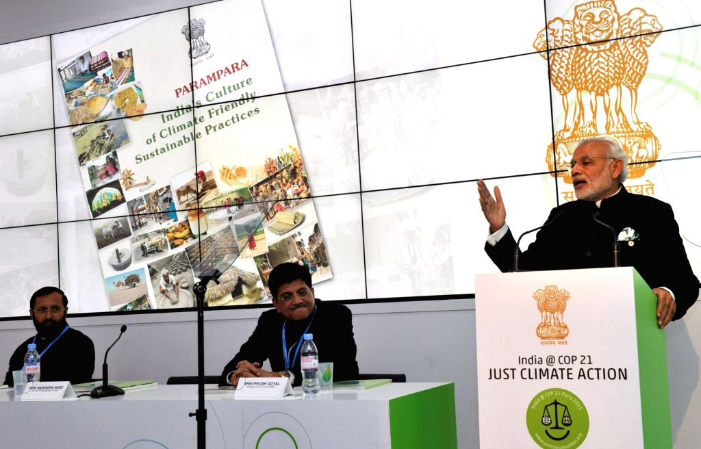 Prime Minister Narendra Modi addresses at the inauguration of the India Pavilion, at COP21 Summit, in Paris, France on Nov 30, 2015. Also seen The Minister of State for Environment, Forest and ... - Narendra Modi