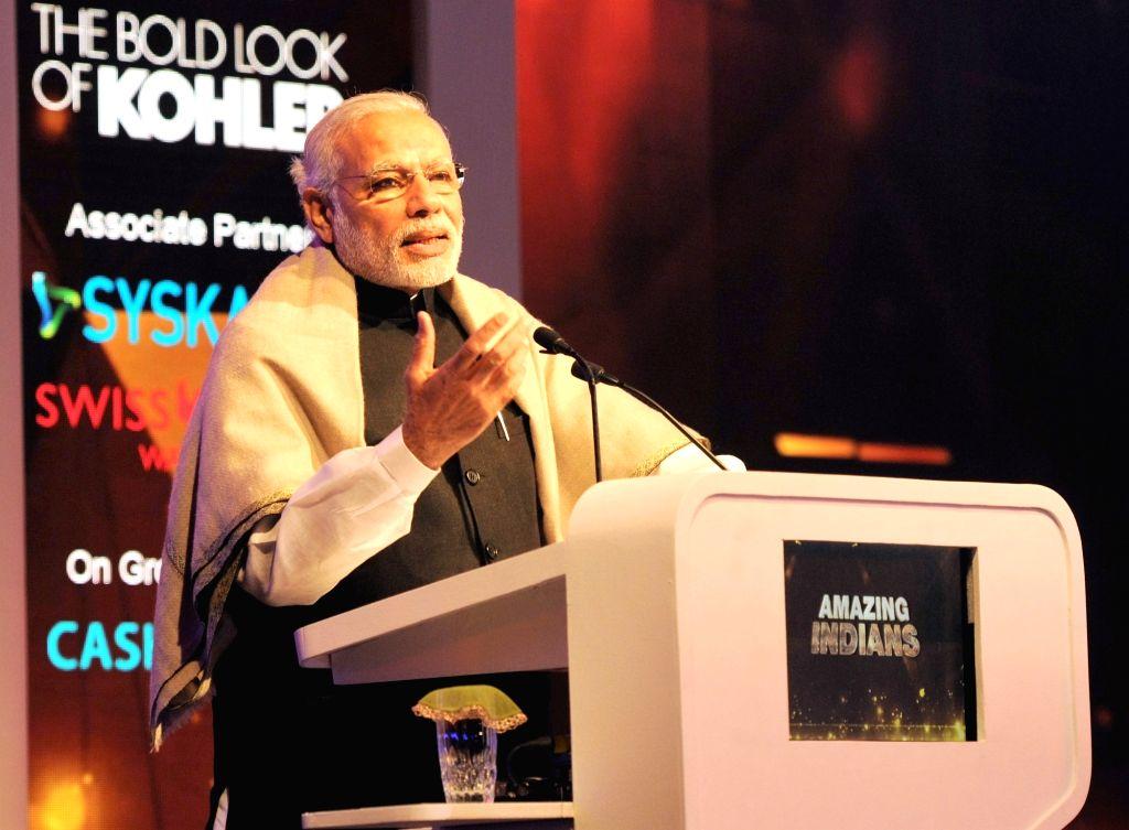 "Prime Minister Narendra Modi addresses at the presentation ceremony of the ""Times Now"" Amazing Indians Awards – 2016, in New Delhi on Jan 14, 2016. - Narendra Modi"