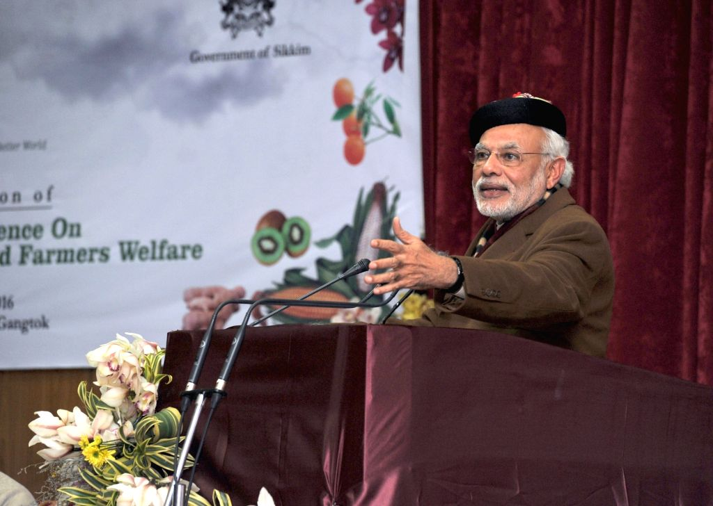 Prime Minister Narendra Modi addresses at the National Conference on Sustainable Agriculture & Farmers Welfare, in Gangtok on Jan 18, 2016. - Narendra Modi