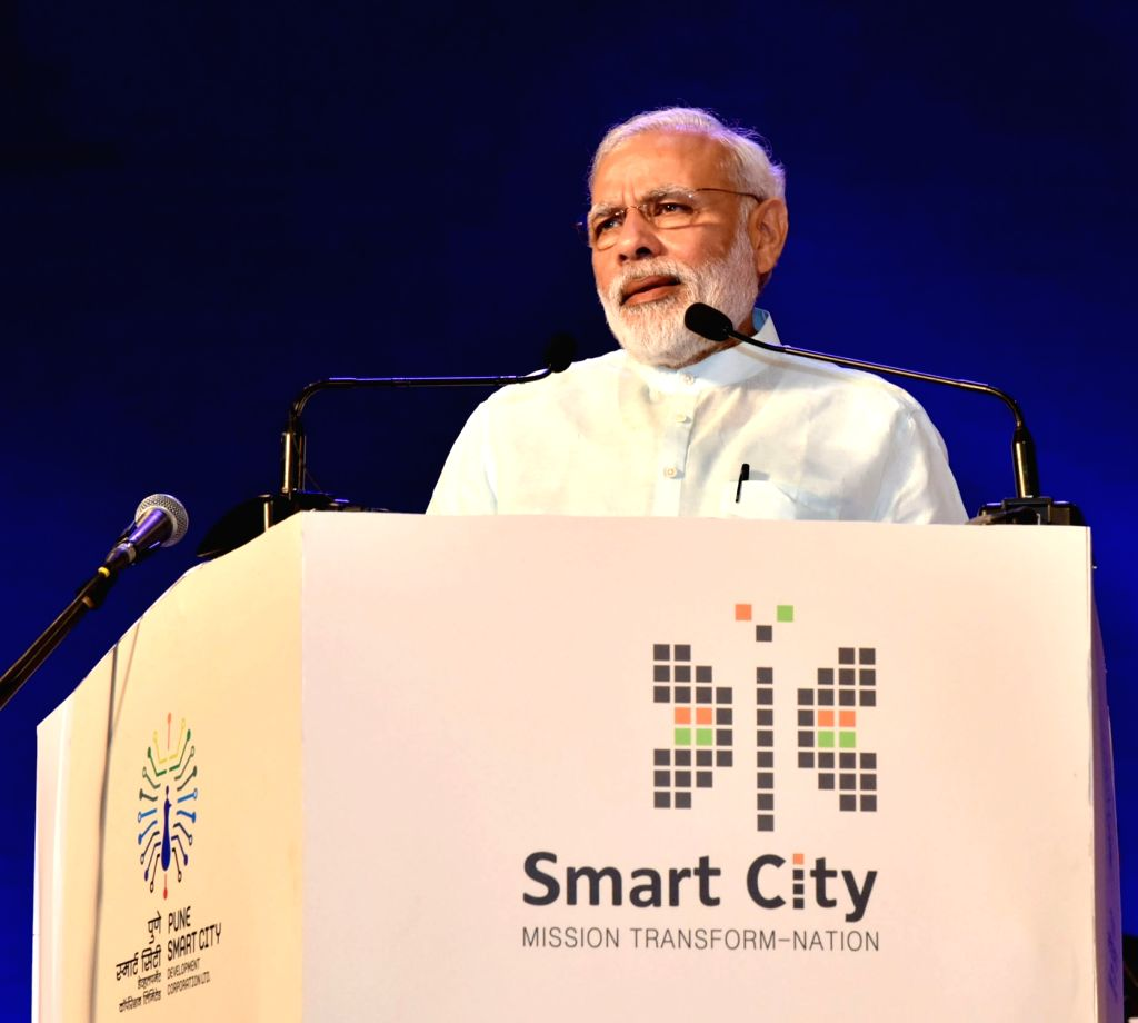 Prime Minister Narendra Modi addresses at the launch of the projects, Smart Cities Mission in Pune on June 25, 2016. - Narendra Modi