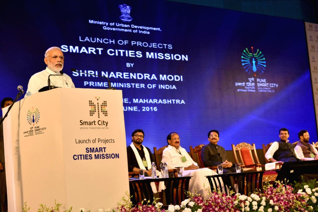 Prime Minister Narendra Modi addresses at the launch of the projects, Smart Cities Mission in Pune on June 25, 2016. Also seen the Maharashtra Governor C Vidyasagar Rao, Chief Minister Devendra ... - Narendra Modi, M Venkaiah Naidu, Babul Supriyo, Prakash Javadekar and C Vidyasagar Rao