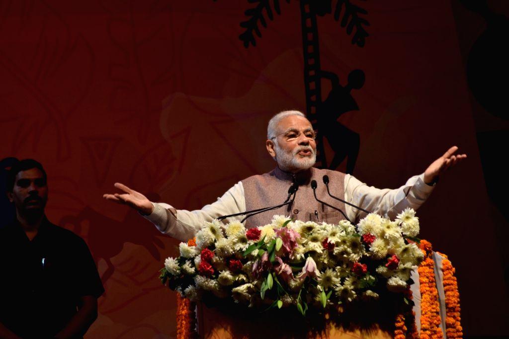 Prime Minister Narendra Modi addresses at the inauguration of National Tribal Carnival-2016, in New Delhi on Oct 25, 2016. - Narendra Modi