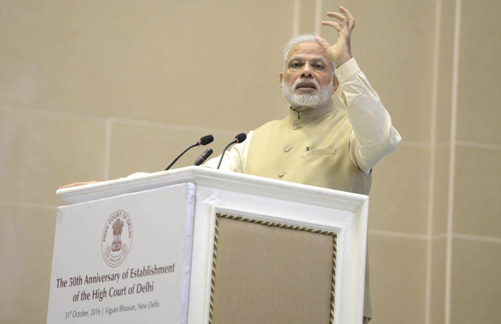 Prime Minister Narendra Modi addresses at the 50th anniversary function of establishment of the Delhi High Court, in New Delhi on Oct 31, 2016. - Narendra Modi
