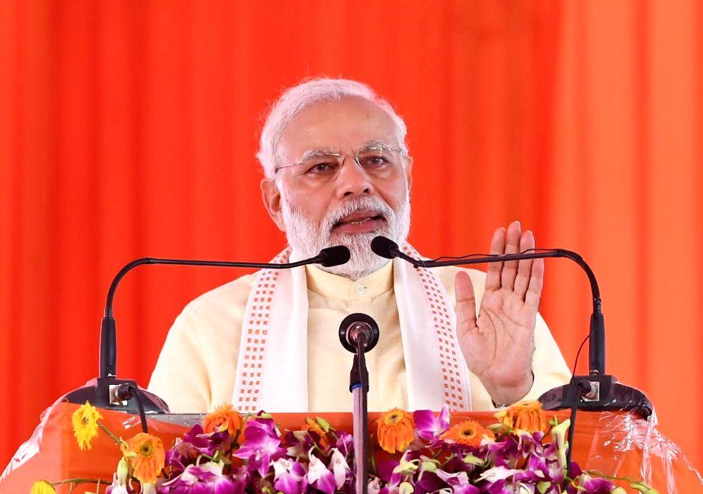Prime Minister Narendra Modi addresses at the foundation stone laying ceremony of Poorvanchal Expressway in Azamgarh, Uttar Pradesh on July 14, 2018. - Narendra Modi