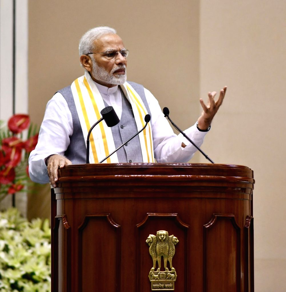 """Prime Minister Narendra Modi addresses at the launch of """"Moving On... Moving Forward: A Year In Office""""a book marking the completion of Naidu's one year as the Vice President ... - Narendra Modi"""
