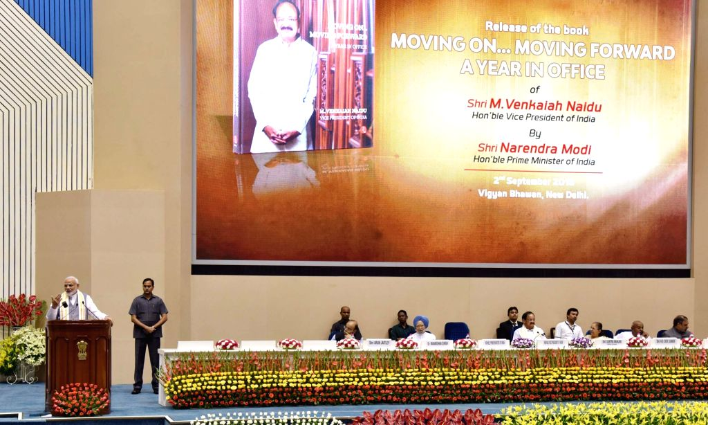 """Prime Minister Narendra Modi addresses at the launch of """"Moving On... Moving Forward: A Year In Office"""" - a book marking the completion of Naidu's one year as the Vice President ... - Narendra Modi"""