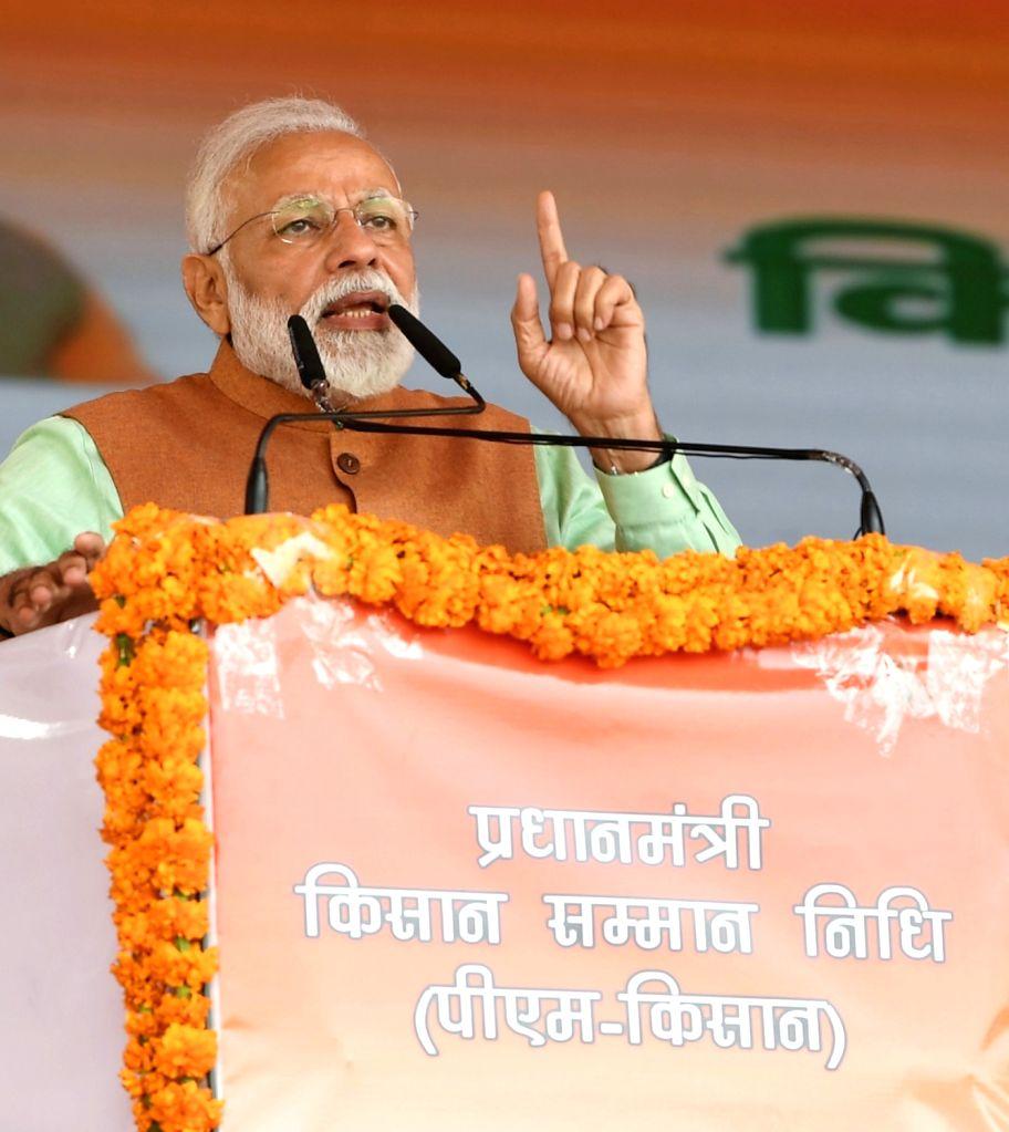 Prime Minister Narendra Modi addresses at the inauguration of the Pradhan Mantri Kisan Samman Nidhi (PM-KISAN) scheme in Uttar Pradesh's Gorakhpur, on Feb 24, 2019. - Narendra Modi