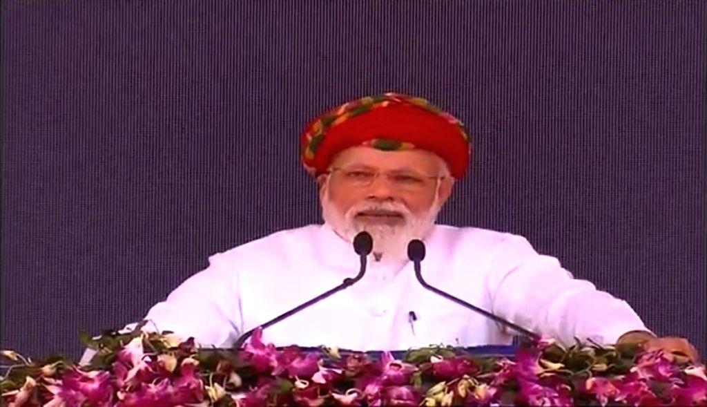 Prime Minister Narendra Modi addresses at the inauguration of development projects in Gujarat's Jamnagar, on March 4, 2019. - Narendra Modi
