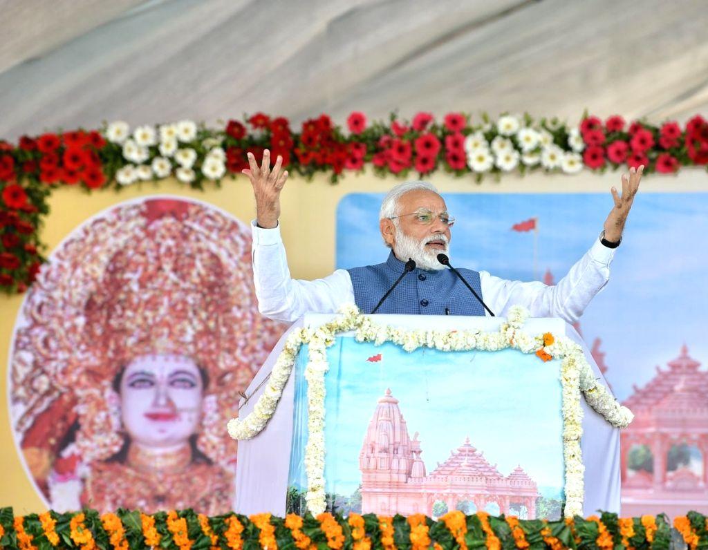 Prime Minister Narendra Modi addresses at the foundation stone laying ceremony of Shikshan Bhavan and Vidyarthi Bhavan in Adalaj, Gujarat, on March 5, 2019. - Narendra Modi