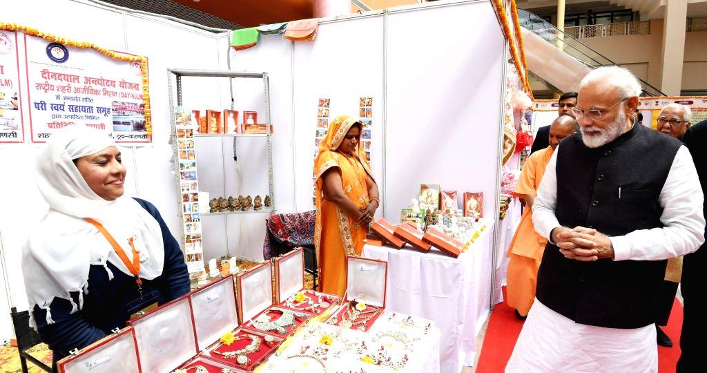 Prime Minister Narendra Modi addresses at the National Women Livelihood Meet - 2019, in Varanasi, Uttar Pradesh, on March 8, 2019. - Narendra Modi