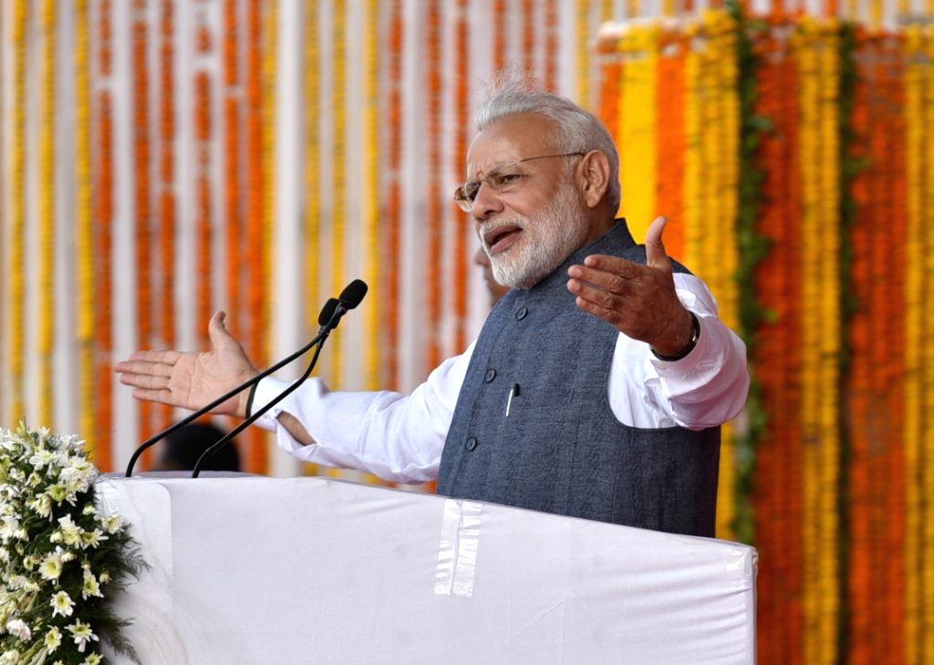 Prime Minister Narendra Modi addresses during Rajyotsav Mela in Naya Raipur on Nov 1, 2016. - Narendra Modi