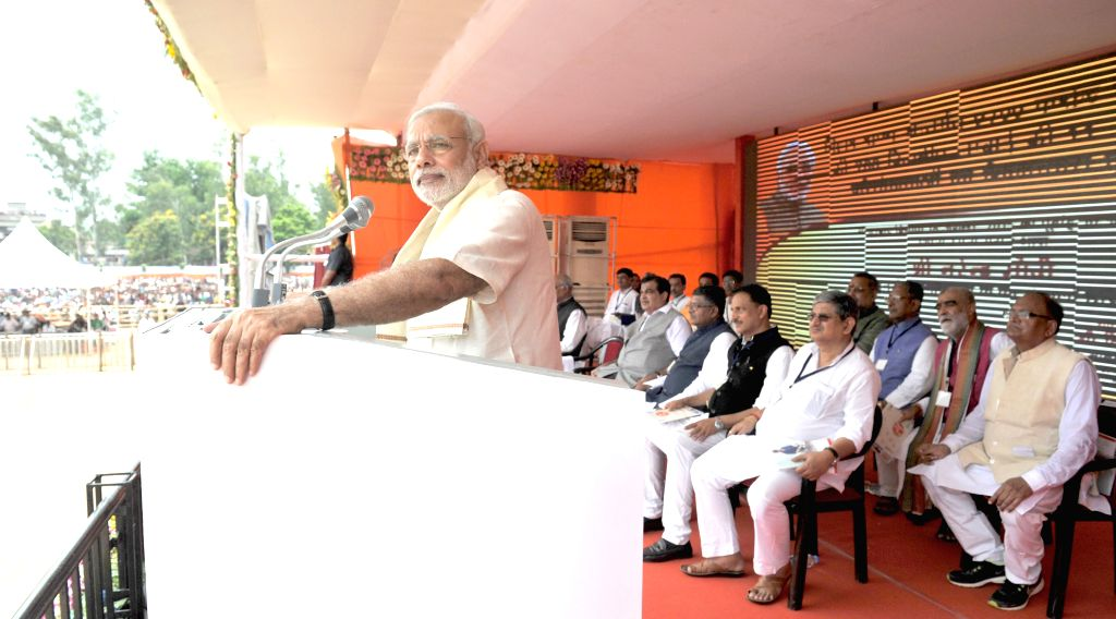 Prime Minister Narendra Modi addresses during a programme organised to dedicate National Highway projects to the nation, in Ara of Bihar on Aug 18, 2015. - Narendra Modi