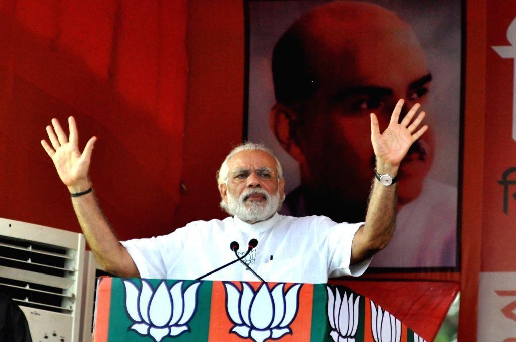 Prime Minister Narendra Modi addresses during a BJP rally in Kolkata, on April 17, 2016. - Narendra Modi