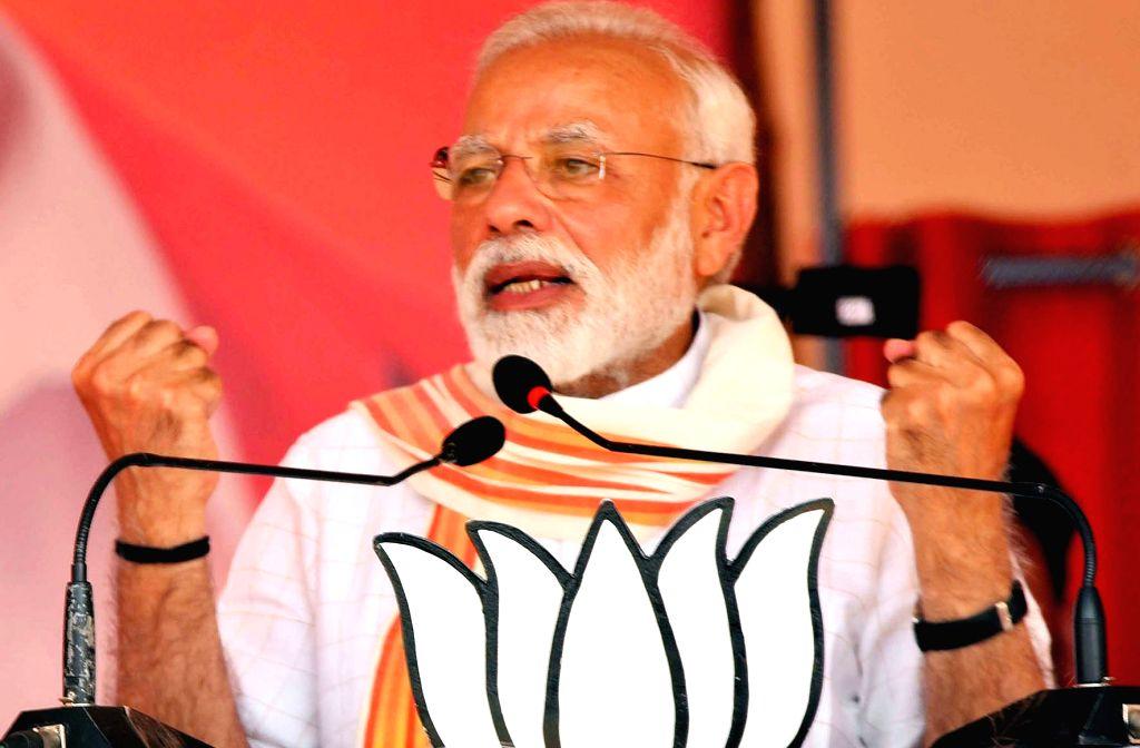 Prime Minister Narendra Modi addresses during a public rally in Karnataka's Chitradurga, on April 9, 2019. - Narendra Modi