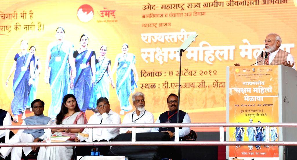 Prime Minister Narendra Modi addresses during a state-level 'Mahila Saksham Melava' or Empowered Women???s Meet of Self Help Groups (SHGs) organised by Maharashtra State Rural Livelihood ... - Narendra Modi