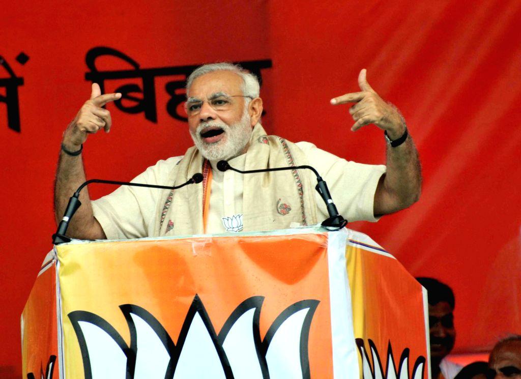 Prime Minister Narendra Modi addresses during the `Parivartan rally` in Saharsa, Bihar, on Aug 18, 2015. - Narendra Modi