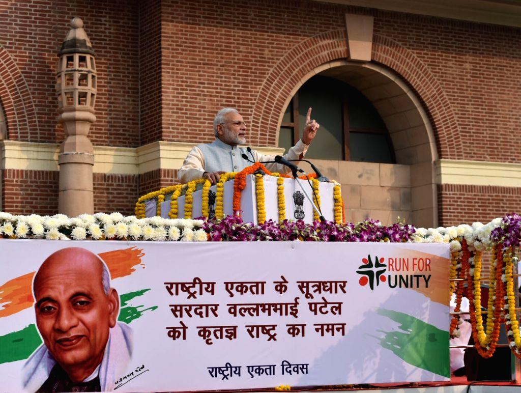 "Prime Minister Narendra Modi addresses during the ""Run for Unity"" ceremony on the occasion of Rashtriya Ekta Diwas at National Stadium in New Delhi on Oct 31, 2016. - Narendra Modi"