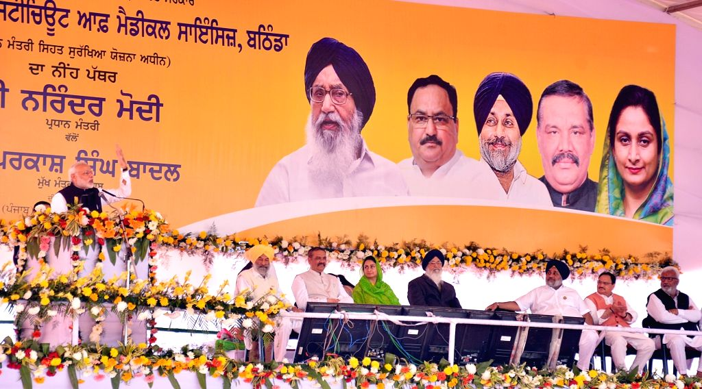 Prime Minister Narendra Modi addresses during the Foundation Stone laying ceremony of All India Institute of Medical Sciences (AIIMS) in Bathinda on Nov 25, 2016. Also seen Punjab Chief ... - Narendra Modi, Parkash Singh Badal, Sukhbir Singh Badal and Harsimrat Kaur