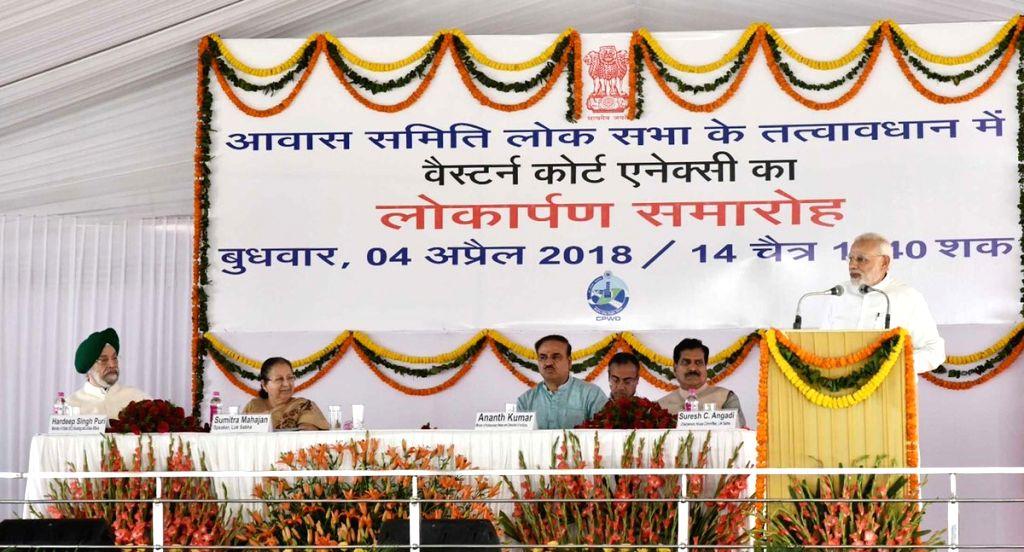 Prime Minister Narendra Modi addresses during the inauguration of new building of Western Court Annexe in New Delhi on April 4, 2018. Also seen Lok Sabha Speaker Sumitra Mahajan and Union ... - Narendra Modi, Ministers Ananth Kumar, Hardeep Singh Puri and Sumitra Mahajan