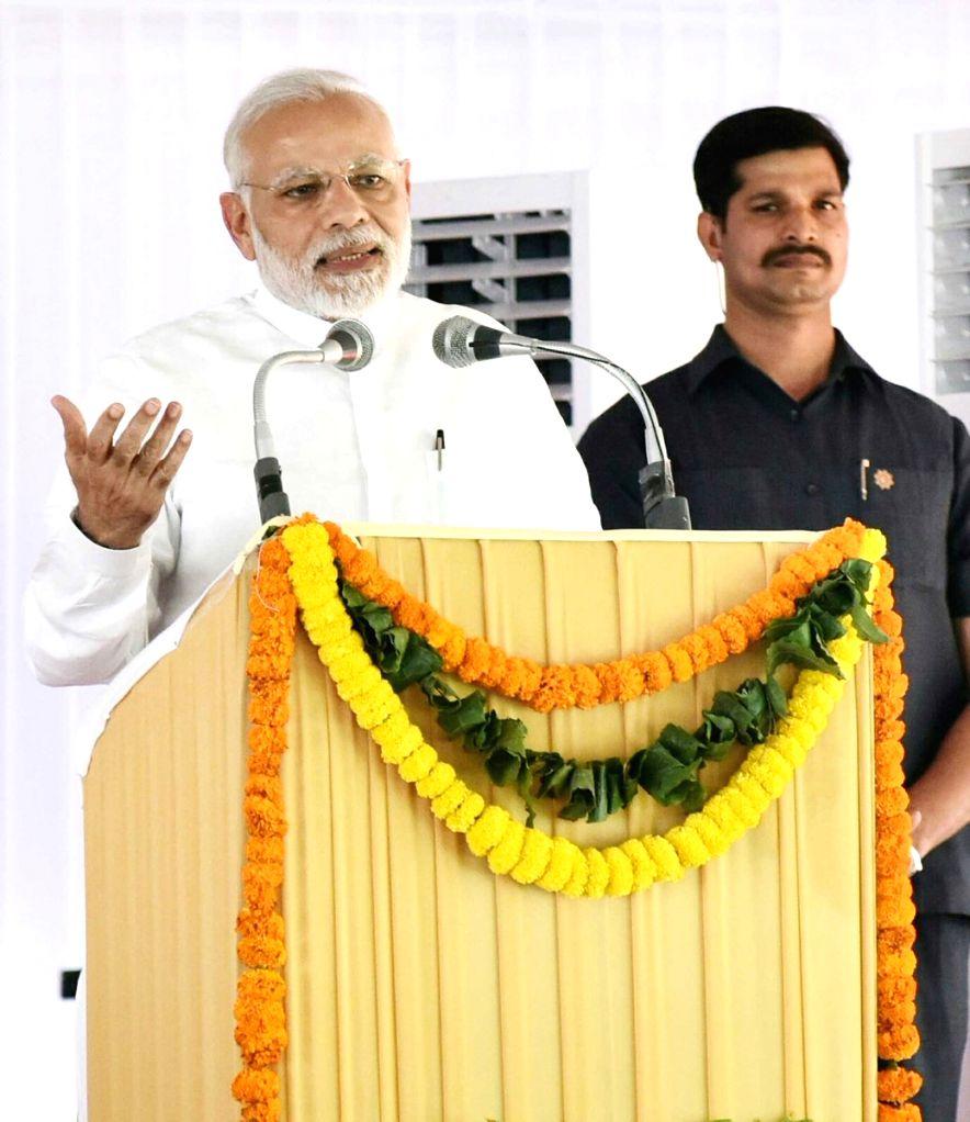 Prime Minister Narendra Modi addresses during the inauguration of new building of Western Court Annexe in New Delhi on April 4, 2018. - Narendra Modi