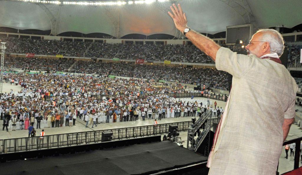 Prime Minister Narendra Modi addresses the gathering at the Indian Community Reception, in Dubai Cricket stadium, UAE on Aug 17, 2015. - Narendra Modi