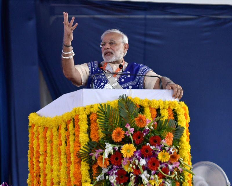 Prime Minister Narendra Modi addressing the gathering, at Limkheda, in Gujarat on Sept 17, 2016. - Narendra Modi