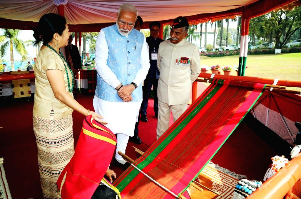 Prime Minister Narendra Modi along with Arunachal Pradesh Governor BD Mishra during an interaction with loin loom weavers in Itanagar, Arunachal Pradesh, on Feb 9, 2019. - Narendra Modi