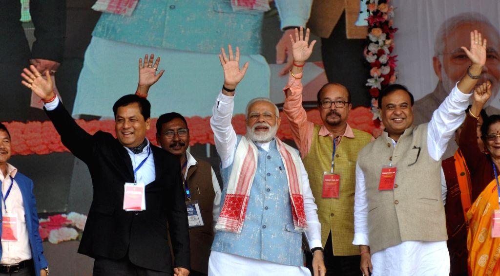 Prime Minister Narendra Modi along with Assam Chief Minister Sarbananda Sonowal and Finance Minister Himanta Biswa Sarma during a public rally at Sangsari near Guwahati, on Feb 9, 2019. - Narendra Modi