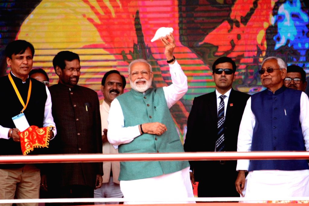Prime Minister Narendra Modi along with Bihar Chief Minister Nitish Kumar, Deputy Chief Minister Sushil Kumar Modi and Union Minister Ramvilas Pasvan at 'Sankalp Rally' in Patna, on March 3, ... - Narendra Modi, Nitish Kumar and Sushil Kumar Modi