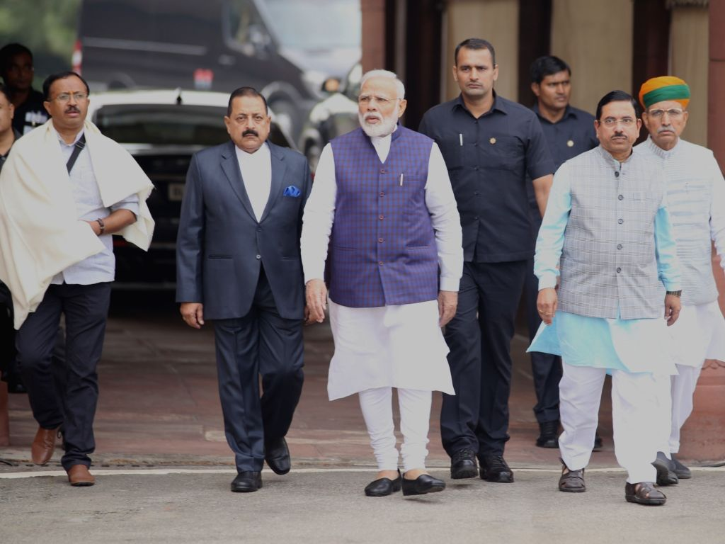 Prime Minister Narendra Modi along with his ministers talking to media persons on the opening day of the winter session at Parliament House in New Delhi on Nov. 18, 2019. - Narendra Modi