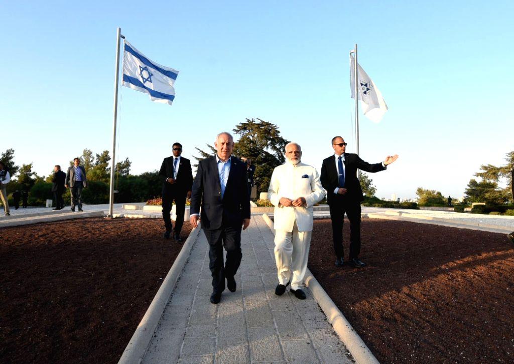 Prime Minister Narendra Modi along with Israeli Prime Minister Benjamin Netanyahu pays homage at the grave of Benjamin Ze'ev (Theodor) Herzel (Visionary of the State), in Jerusalem, Israel on July ... - Narendra Modi