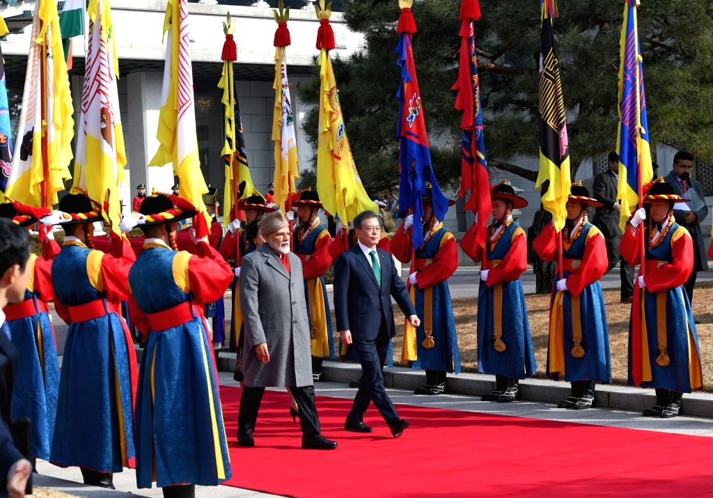 Prime Minister Narendra Modi along with South Korea President Moon Jae-in inspects the Guard of Honour during a ceremonial reception organised for him, in Seoul, South Korea, on Feb 22, 2019. - Narendra Modi