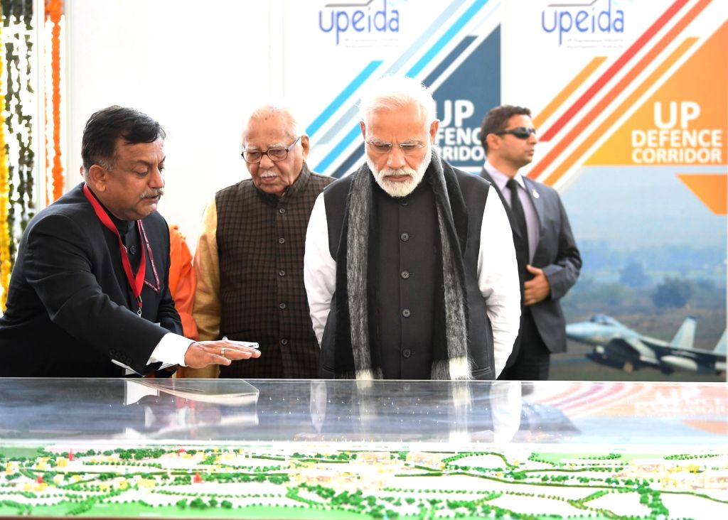 Prime Minister Narendra Modi along with Uttar Pradesh Governor Ram Naik during a prorgamme organsied to inaugurate development projects, in Jhansi of Uttar Pradesh, on Feb 15, 2019. - Narendra Modi