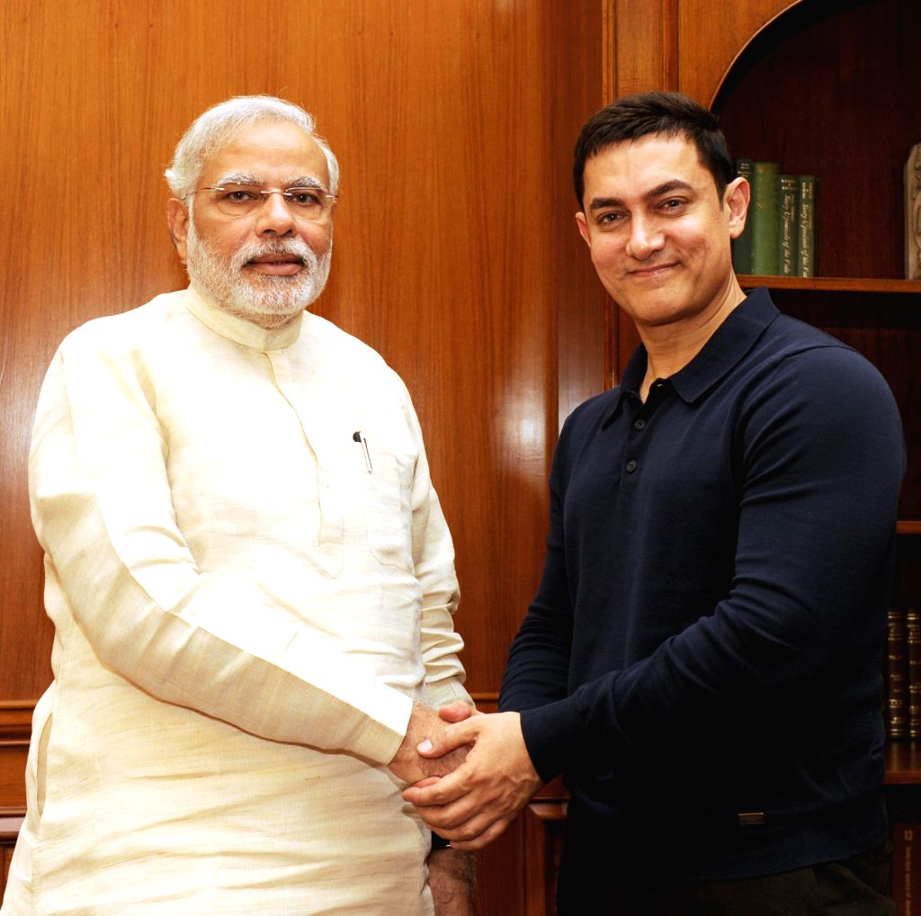 Prime Minister Narendra Modi and actor Aamir Khan during a meeting in New Delhi on June 23, 2014.