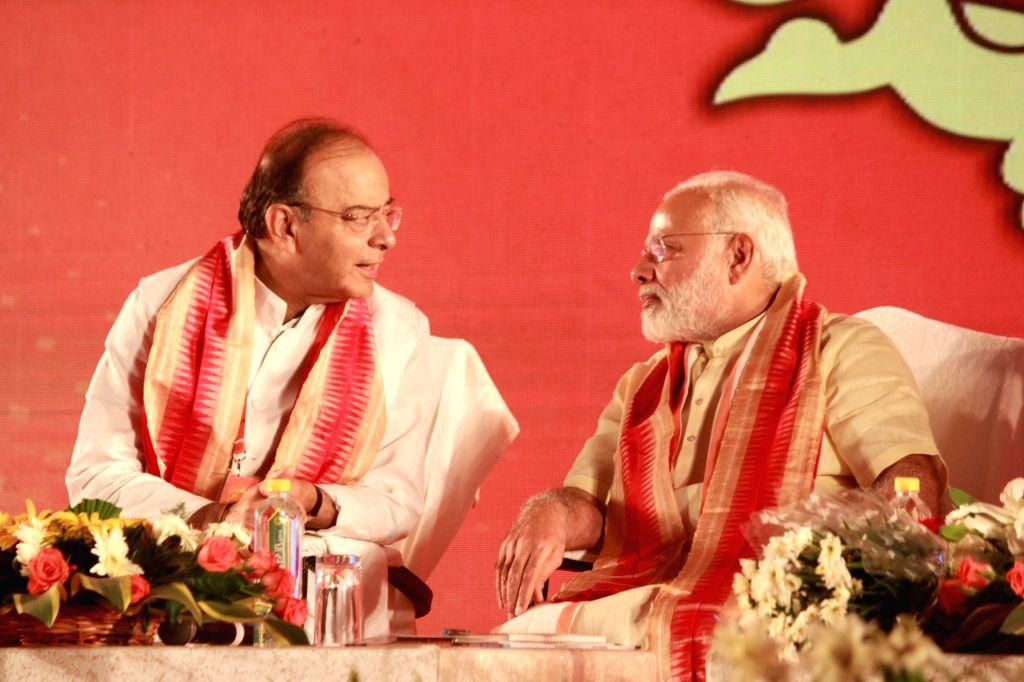 Prime Minister Narendra Modi and Arun Jaitley. (Photo: IANS) - Narendra Modi and Arun Jaitley
