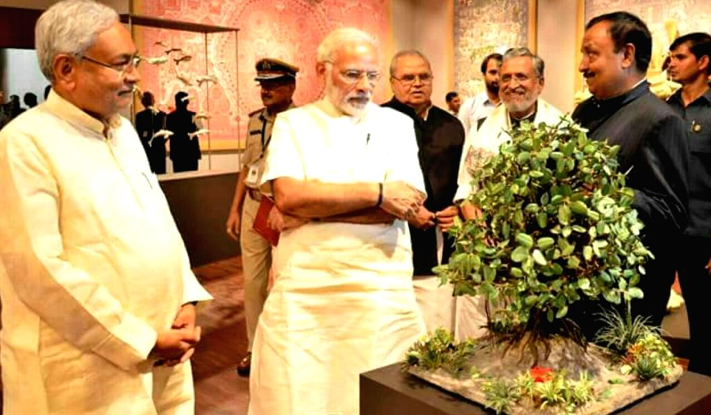 Prime Minister Narendra Modi and Bihar Chief Minister Nitish Kumar with Sanjay Jha. - Narendra Modi and Nitish Kumar