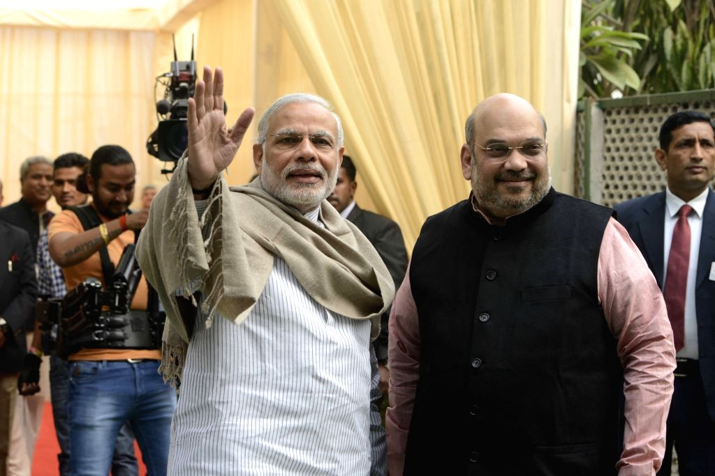 "Prime Minister Narendra Modi and BJP chief Amit Shah during ""Diwali Mangal Milan"" programme at BJP headquarters  in New Delhi, on Nov 28, 2015. - Narendra Modi and Amit Shah"