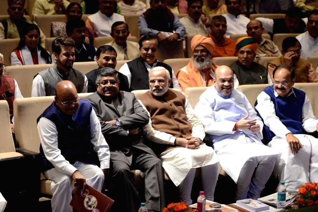 Prime Minister Narendra Modi and BJP chief Amit Shah with Union Law and Justice Minister Ravi Shankar Prasad and Union Minister for Urban Development, Housing and Urban Poverty Alleviation ... - Narendra Modi, M. Venkaiah Naidu, Amit Shah and Ananth Kumar