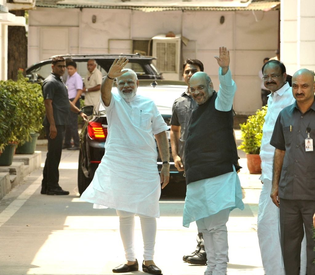 Prime Minister Narendra Modi and BJP chief Amit Shah arrive to attend BJP Parliamentary Board meeting in New Delhi on June 19, 2017. - Narendra Modi and Amit Shah