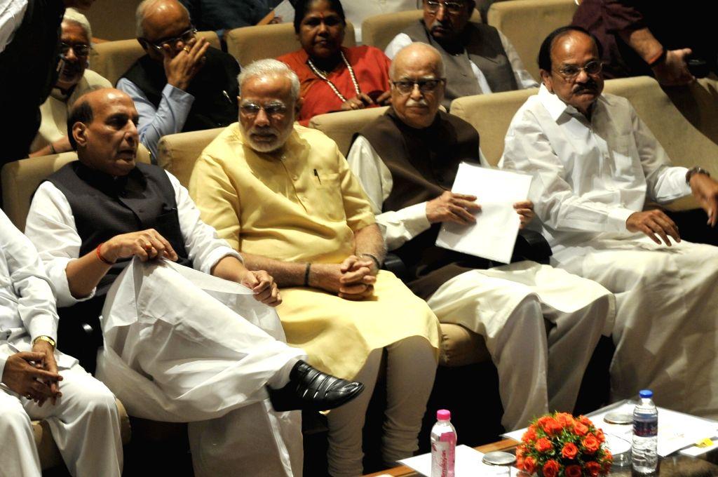 Prime Minister Narendra Modi and BJP veteran L.K. Advani Union Home Minister Rajnath Singh and Union Urban Development, Housing and Urban Poverty Alleviation, Information & ... - Narendra Modi, M. Venkaiah Naidu and Rajnath Singh