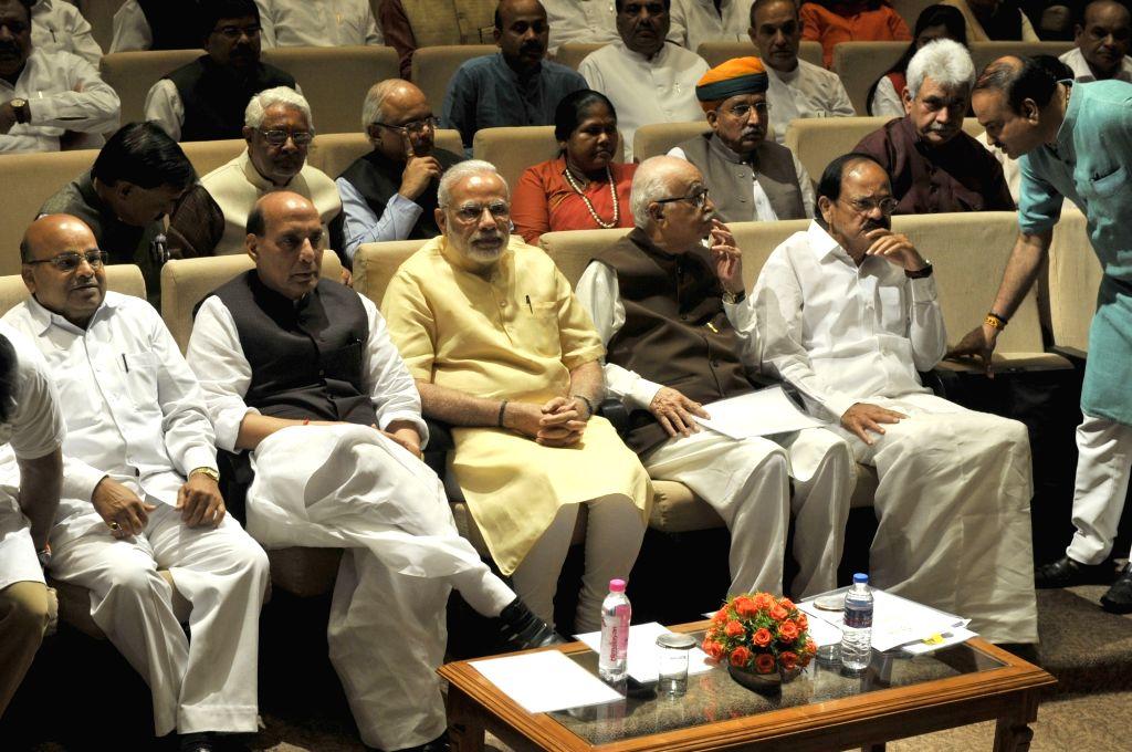 Prime Minister Narendra Modi and BJP veteran L.K. Advani with Union Ministers Thawar Chand Gehlot, Rajnath Singh, M Venkaiah Naidu, Manoj Sinha, Niranjan Jyoti and others during BJP ... - Narendra Modi, Thawar Chand Gehlot, Rajnath Singh, M Venkaiah Naidu, Manoj Sinha, Niranjan Jyoti and K. Advani