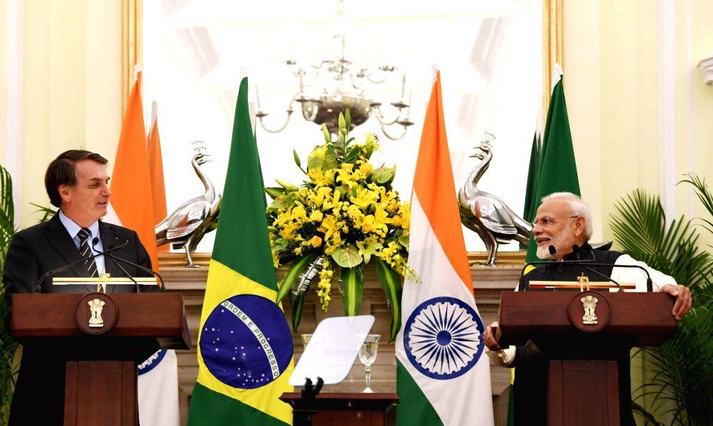 Prime Minister Narendra Modi and Brazilian President Jair Bolsonaro issue Joint Press Statement at Hyderabad House in New Delhi on Jan 25, 2020. - Narendra Modi
