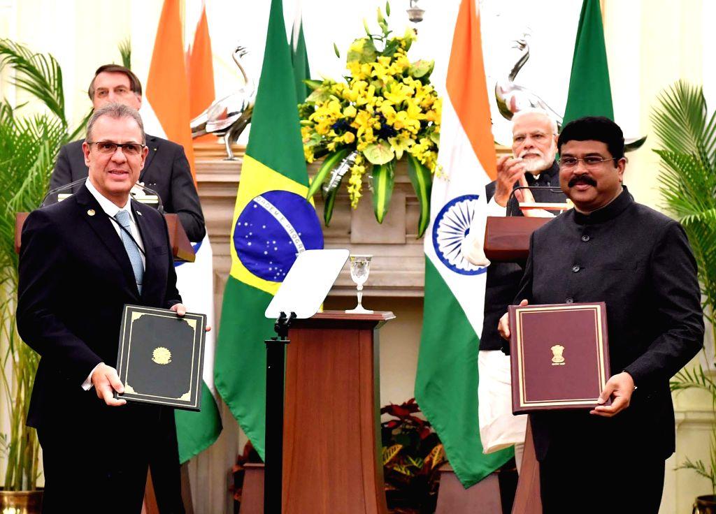 Prime Minister Narendra Modi and Brazilian President Jair Bolsonaro witness the exchange of agreements at Hyderabad House in New Delhi on Jan 25, 2020. - Narendra Modi